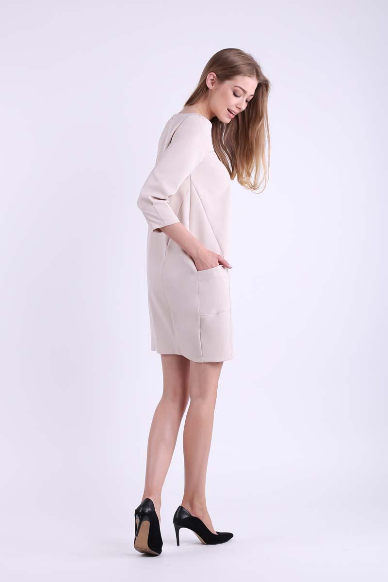 Beige short knitted dress with pockets