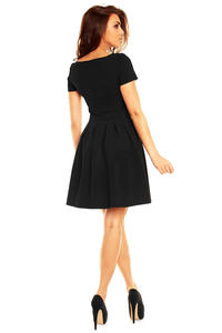 Black Pleated Seam Dress with Metallic Emblem