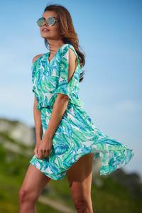 A flimsy green summer dress with flowers and slit sleeves