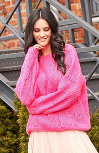 Loose pink sweater with an openwork pattern