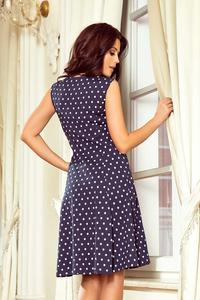Navy blue flared dress in polka dots with neckline