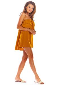 An airy camel mini dress with a Spanish neckline