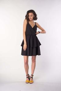 A black dress on straps with an assumed neckline