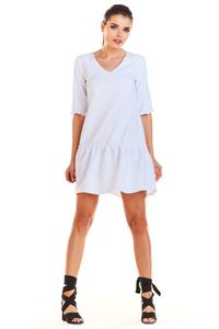 White V-neck dress with a frill at the bottom